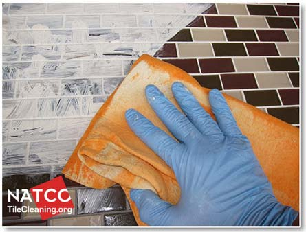 cleaning excess grout dye off of the tiles