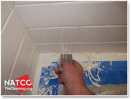 removing moldy caulk in a tile shower
